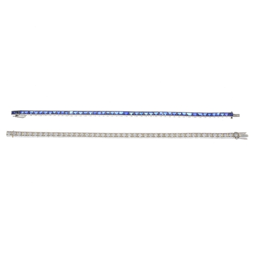 56 - Two mid 20th century platinum gem-set bracelets. To include an old-cut diamond line bracelet with en...