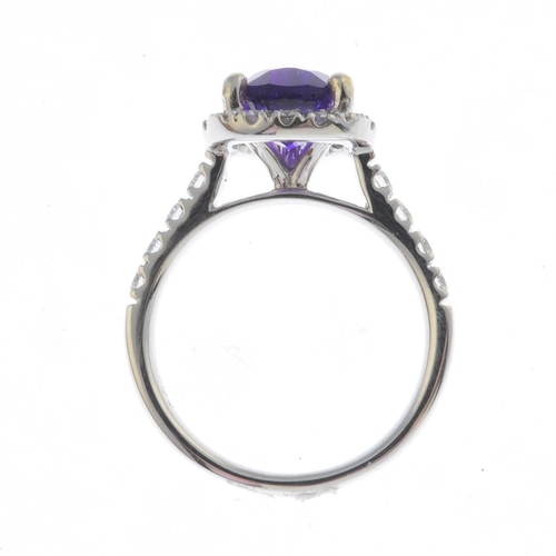 6 - An 18ct gold amethyst and diamond cluster ring. The pear-shape amethyst, with brilliant-cut diamond ...