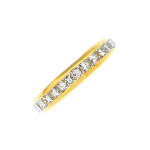 8 - A diamond full eternity ring. Designed as a square-shape diamond line, within a channel setting. Tot...
