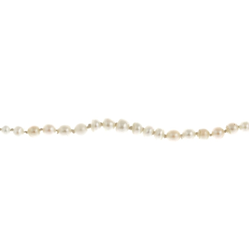 17 - A natural pearl single-strand bracelet. Comprising forty-seven graduated natural pearls, measuring 5...
