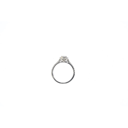 23 - A 9ct gold diamond cluster ring. The brilliant-cut diamond, within a similarly-cut diamond surround ...