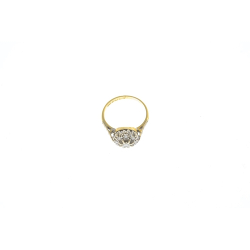27 - A 1960s 18ct gold diamond cluster ring. The brilliant-cut diamond, with circular-cut diamond surroun...