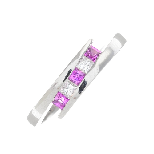 32 - An 18ct gold pink sapphire and diamond dress ring. Of asymmetric design, the alternating square-shap...