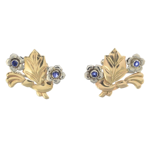 48 - A pair of sapphire floral earrings. Each designed as two circular-shape sapphire flowers, within a b...
