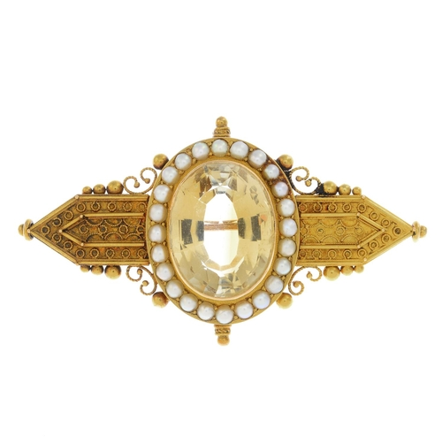 49 - A late Victorian 15ct gold citrine and split pearl brooch. Designed as an oval-shape citrine and spl...