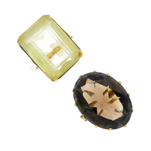 55 - Two gem-set rings. To include a 9ct gold oval-shape smoky quartz single-stone ring, together with a ...