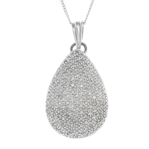 6 - A 9ct gold diamond pendant. Designed as a pave-set diamond pear-shape drop, with pierced openwork re...