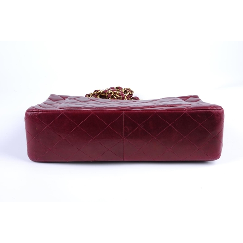 ae911b19fc52ff 40 - CHANEL - a burgundy Jumbo Classic Flap handbag. Featuring a burgundy  quilted lambskin