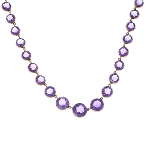 37 - A late 19th century gold amethyst necklace. Designed as a graduated circular-shape amethyst line, wi...