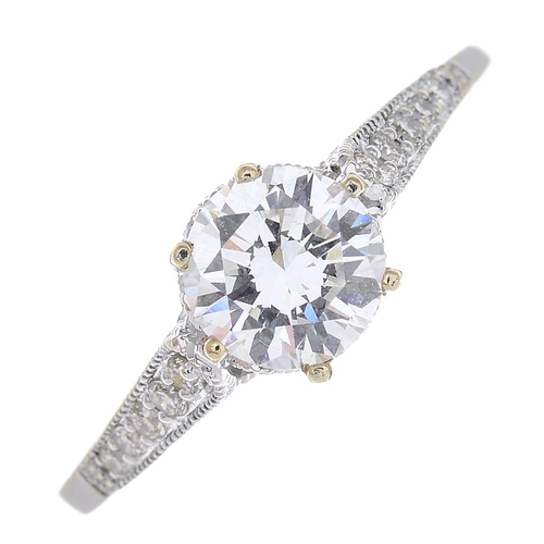 59 - A diamond single-stone ring. The brilliant-cut diamond, with similarly-cut diamond line gallery and ...