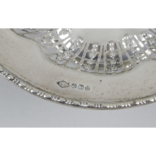 20 - An early twentieth century small silver pedestal dish, the circular form with bead rim and wide pier...