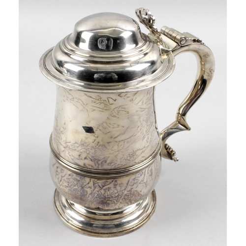 37 - An early George III plain silver tankard, of baluster form with lower girdle detail above a footed b...