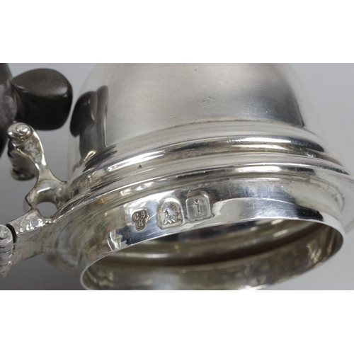 52 - An Edwardian Britannia silver cafe-au-lait pot, the plain tapered form with hinged and domed lid to ...
