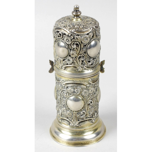 9 - A late Victorian silver lighthouse caster, the cylindrical form ornately chased and embossed through...