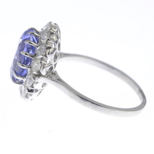 1 - A Sri Lankan colour-change sapphire and diamond cluster ring. The cushion-shape colour-change sapphi...