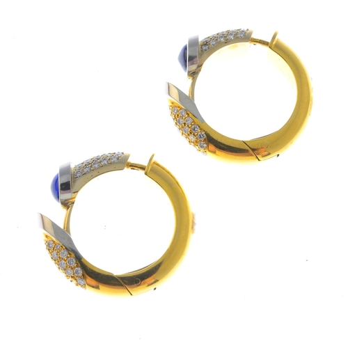 11 - A pair of 18ct gold sapphire and diamond earrings. Each designed as a bi-colour hinged hoop, the pav...