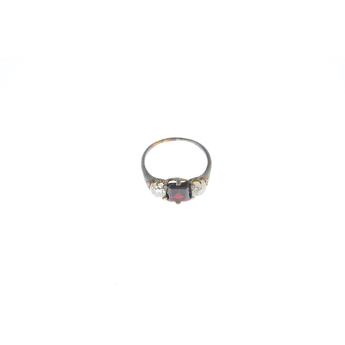 13 - A late Victorian 18ct gold garnet and diamond three-stone ring. The replacement rectangular-shape ga...
