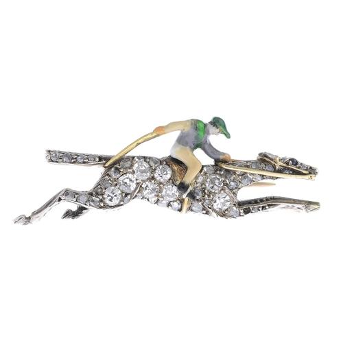 16 - A mid 20th century diamond and enamel brooch. Designed as a polychrome enamel jockey, atop a pave-se...