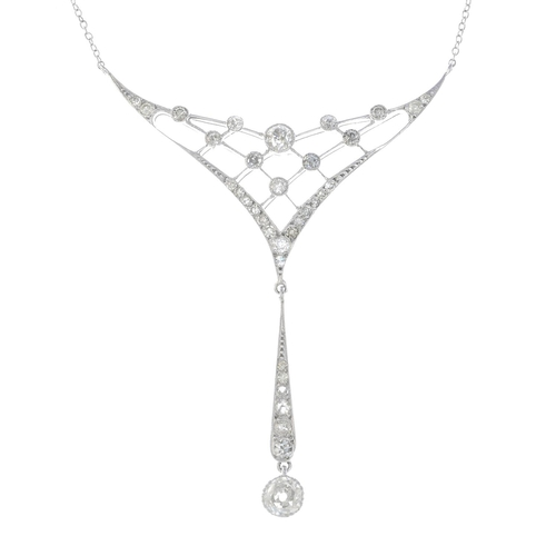 18 - An 18ct gold diamond necklace. The old-cut diamond collet and tapered panel line, suspended from a s...