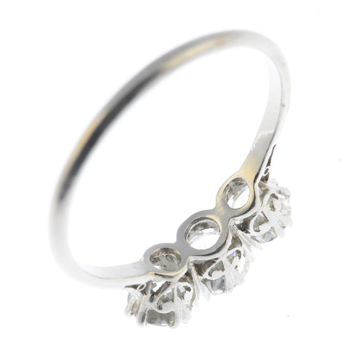 19 - A diamond three-stone ring. The slightly graduated brilliant-cut diamond line, with plain band. Esti...