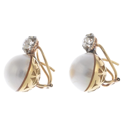 2 - A pair of mabe pearl and diamond earrings. Each designed as a mabe pearl, with old-cut diamond surmo...