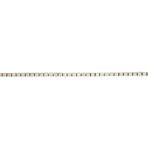 20 - A diamond bracelet. The brilliant-cut diamond line, with partially concealed push-piece clasp. Estim...