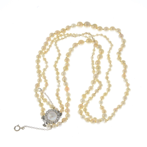 23 - An early 20th century natural pearl two-row necklace. Comprising two slightly graduated pearl lines,...