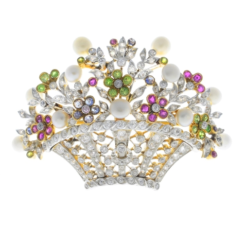24 - An Edwardian platinum and 18ct gold, diamond and gem-set brooch. The old-cut diamond lattice basket,...