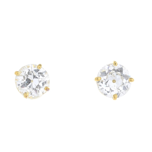 27 - A pair of old-cut diamond stud earrings. Estimated total diamond weight 1.85cts, G-H colour, SI2-P1 ...