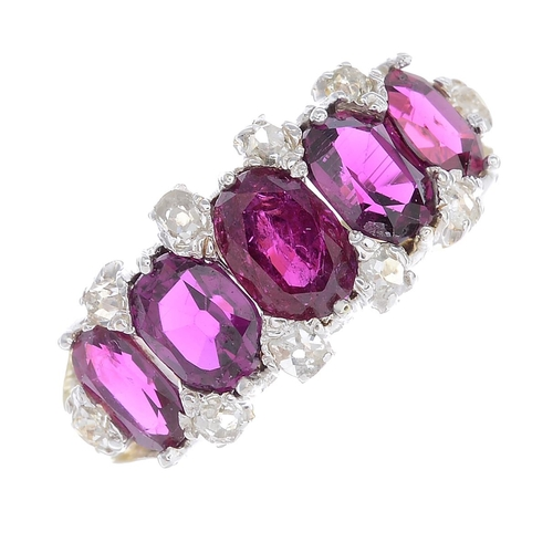 31 - A Thai ruby and diamond ring. The graduated oval-shape ruby line, with old-cut diamond double spacer...