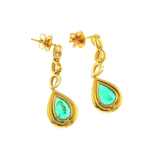 34 - A pair of 18ct gold emerald and diamond earrings. The pear-shape emerald and pave-set diamond surrou...