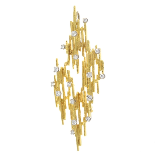 36 - A 1970s 18ct gold diamond brooch. Of abstract design, comprising a series of textured bars, with sca...