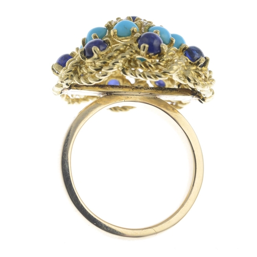39 - A mid 20th century gold sapphire, diamond and turquoise ring. The sapphire cabochon, brilliant-cut d...