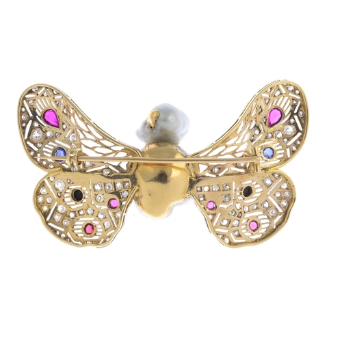 4 - A natural pearl, diamond and gem-set butterfly brooch. The grey baroque pearl body, with red gem eye...