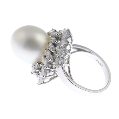 41 - A cultured pearl and diamond cluster ring. The cultured pearl, measuring approximately 16 by 12.2mms...