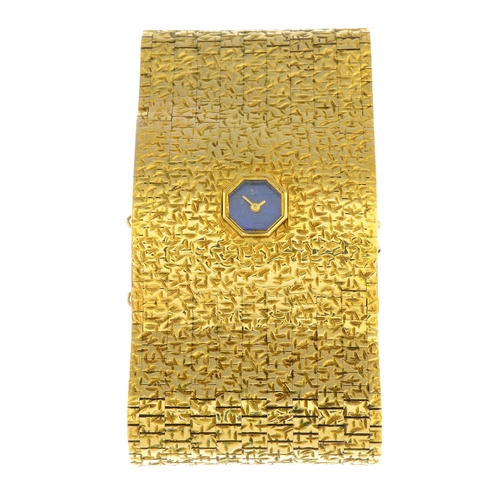 47 - MILNER - a lady's 1960s 9ct gold and lapis lazuli wrist watch. The wide, textured bracelet, with oct...