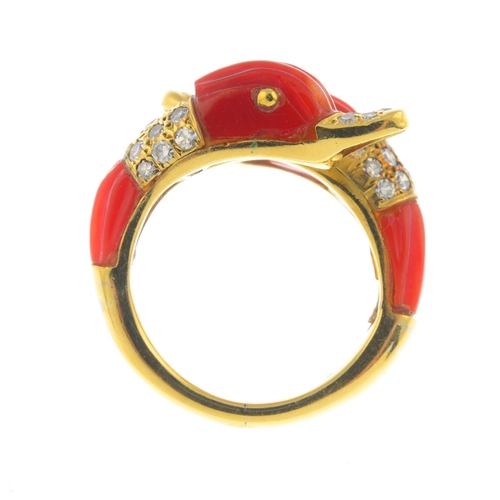 48 - A mid 20th century 18ct gold coral and diamond ring. Comprising two grooved coral and pave-set diamo...