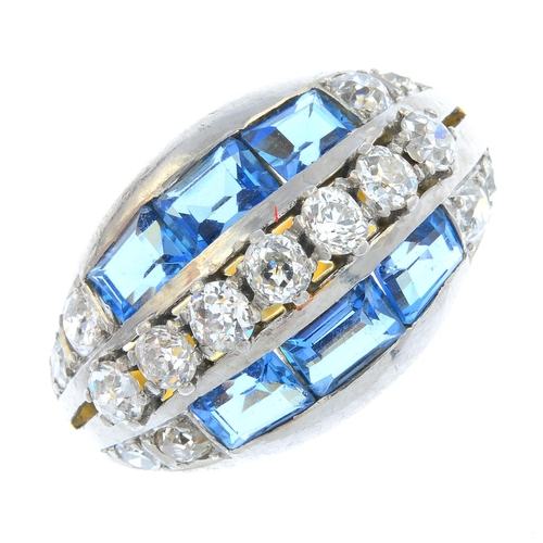 52 - A mid 20th century 18ct gold and platinum diamond and topaz ring. Of marquise-shape outline, the old...