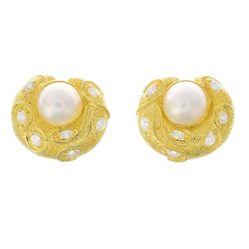 58 - A pair of mabe pearl diamond earrings. Each designed as a mabe pearl, with scattered marquise-shape ...