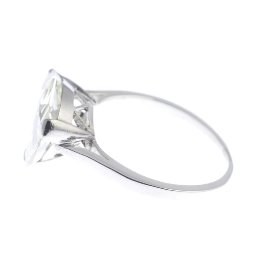 6 - A diamond single-stone ring. The fancy-shape diamond, with plain band. Diamond weight 4.57cts, estim...