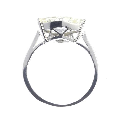6 - A diamond single-stone ring. The fancy-shape diamond, with plain band. Diamond weight 4.57cts, estim...