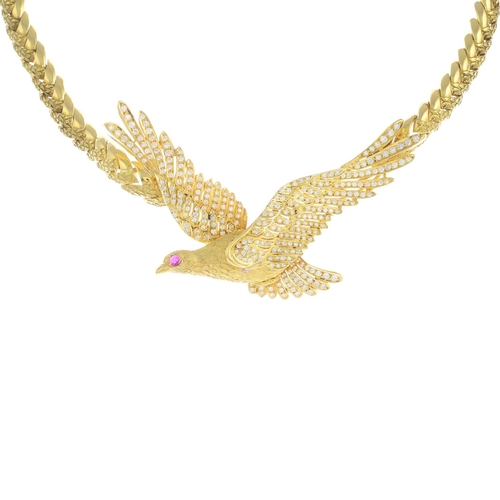 61 - A diamond and ruby necklace. Designed as a bird in flight, with pave-set diamond wings, circular-sha...