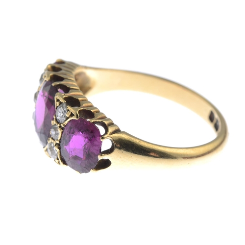 1 - A late Victorian 18ct gold Thai ruby three-stone and diamond ring. The graduated cushion-shape ruby ...
