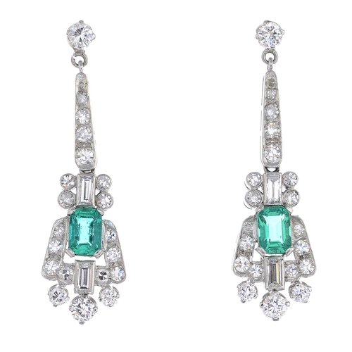 13 - A pair of Colombian emerald and diamond earrings. Each designed as a rectangular-shape emerald, with...