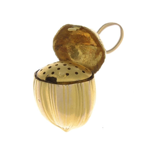2 - An early 20th century 18ct gold pendant vinaigrette. Designed as a hazelnut, opening to reveal a pie...