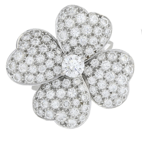 20 - VAN CLEEF & ARPELS - an 18ct gold diamond 'Cosmos' ring. The brilliant-cut diamond, raised to the pa...