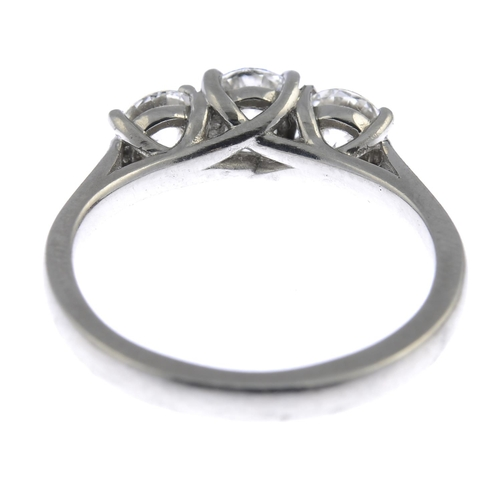 21 - A platinum diamond three-stone ring. The brilliant-cut diamond, weighing 0.43ct, with similarly-cut ...