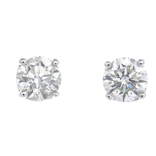 27 - A pair of brilliant-cut diamond stud earrings. Estimated total diamond weight 0.90ct, J-K colour, SI...