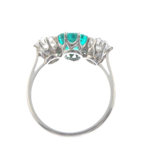 30 - A platinum Colombian emerald and diamond three-stone ring. The pear-shape emerald, with old-cut diam...