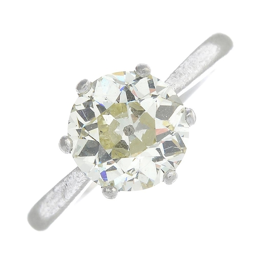 32 - A diamond single-stone ring. The old-cut diamond, with tapered shoulders. Estimated diamond weight 2...